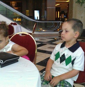 The Boy and his cousin watching a DVD before the wedding