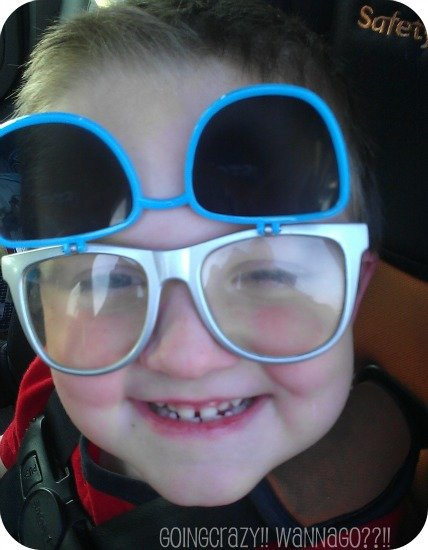 boy wearing silly glasses