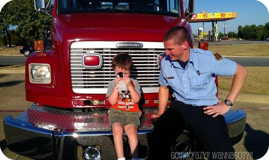 sitting on a fire truck