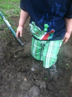 boy playing in the mud