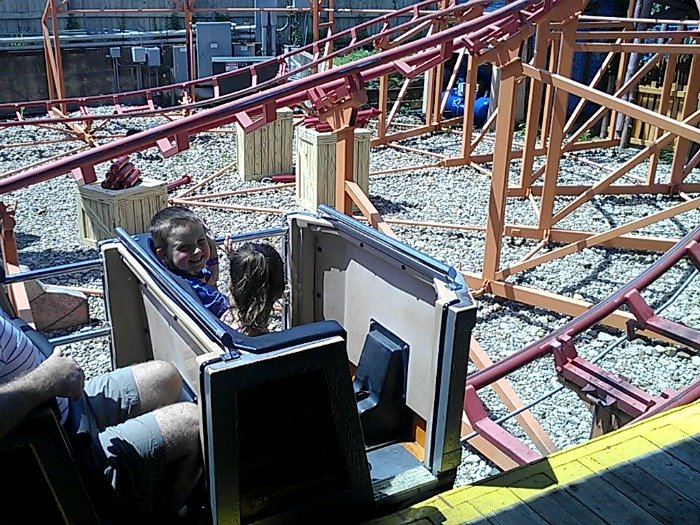 sitting in the front of the rollercoaster
