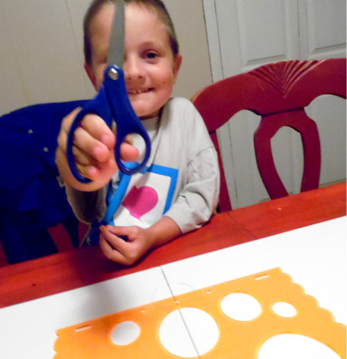 my boy loves to cut paper with Fiskars scissors #Fiskars4Kids #shop #cbias