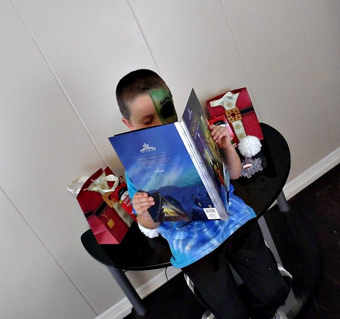 Benjamin had to stop and take the time to read his Northpole book during his Northpole Party #NorthpoleFun #CollectiveBias #ad