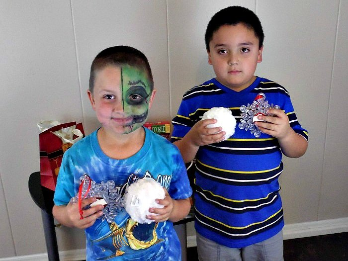 Benjamin and D showing off their snowflakes and snowballs #NorthpoleFun #CollectiveBias #ad