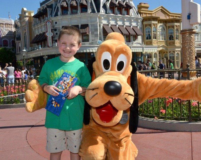 Benjamin and Pluto at Magic Kingdom