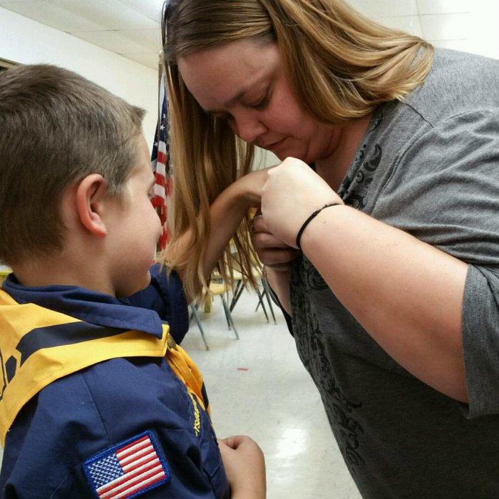 Pinning for Bobcat Badge at Boy Scouts